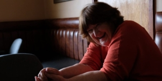 Picture of Patricia Gwynne in the pub, laughing