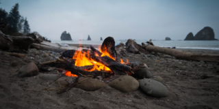 Close up photography of bonfire on beach sand