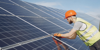 Young engineer checking maintenance of solar panels