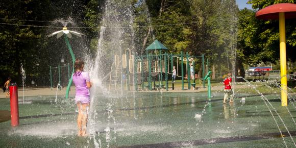 Kids play in a splash park