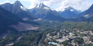 An aerial view of Gold River with the mountains in the background.