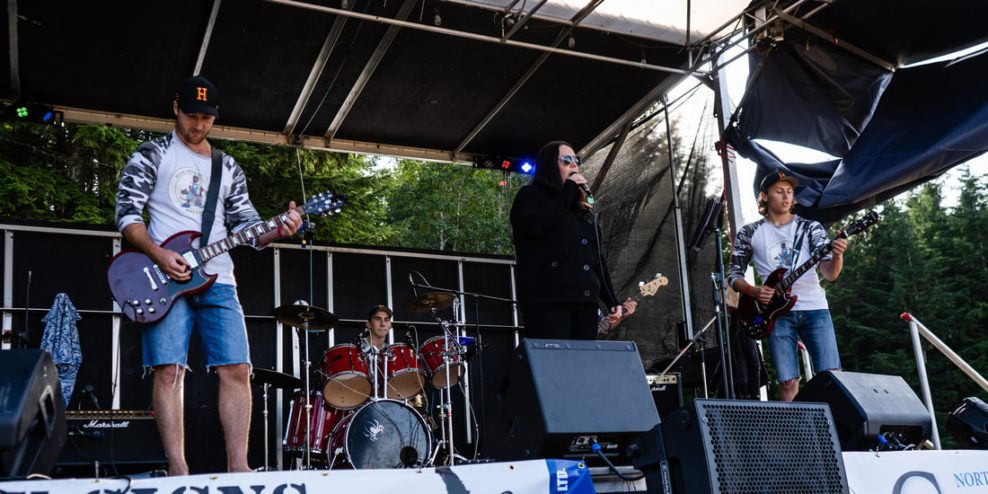 A band plays on an outdoor stage.