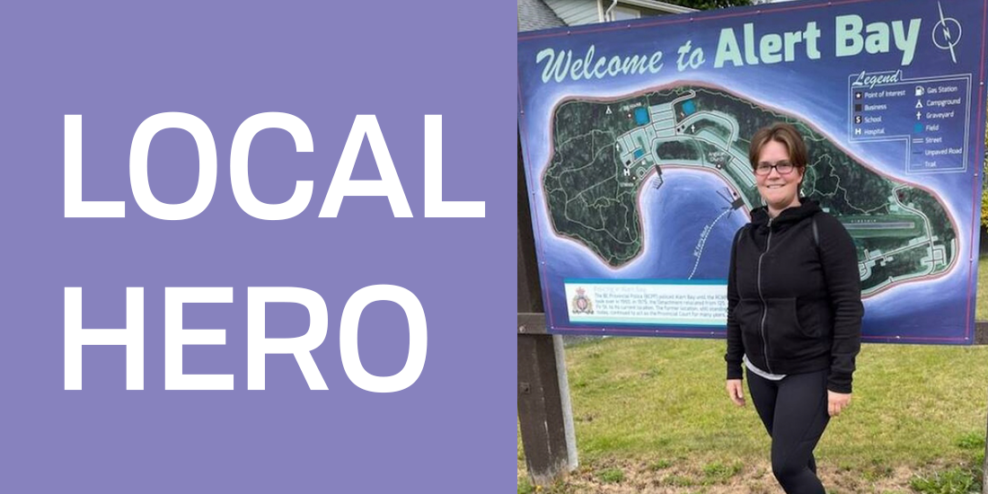 """A portrait of Denise Laforest in front of a sign that reads """"Welcome to Alert Bay"""". Beside her are the words """"Local hero"""" in all caps."""